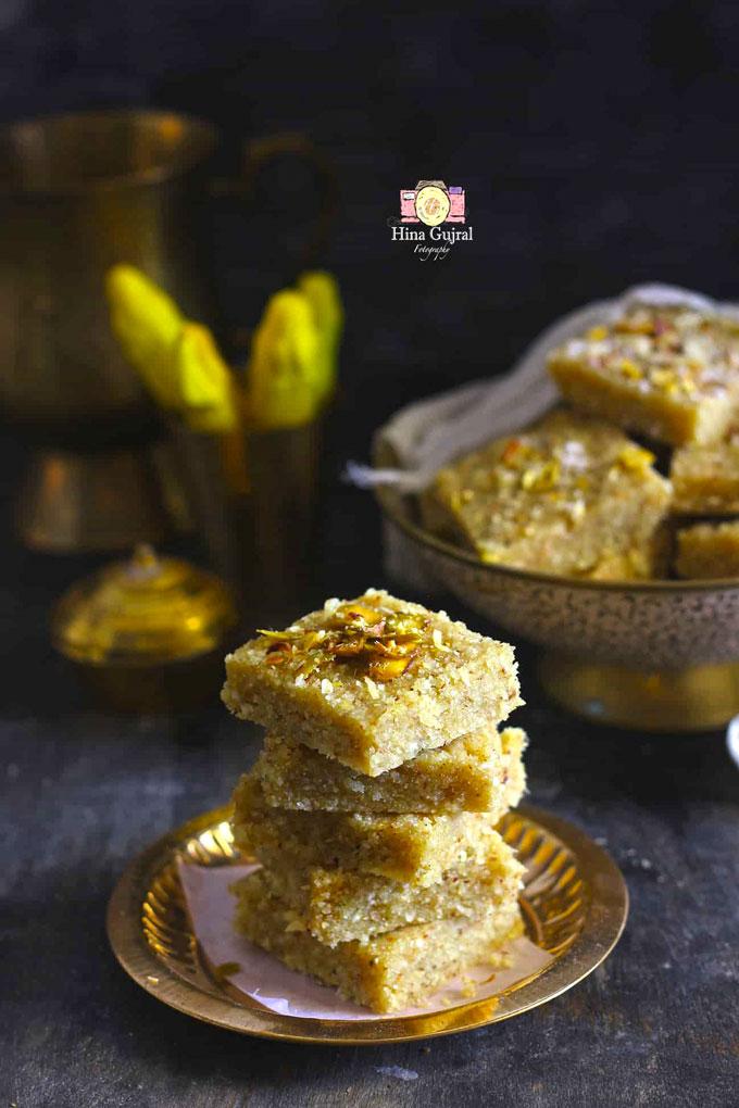 side shot of prasad panjiri stacked in a golden serving platter