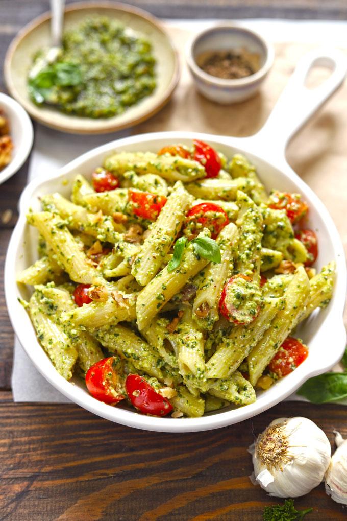side top shot of basil pesto pasta in a white pan
