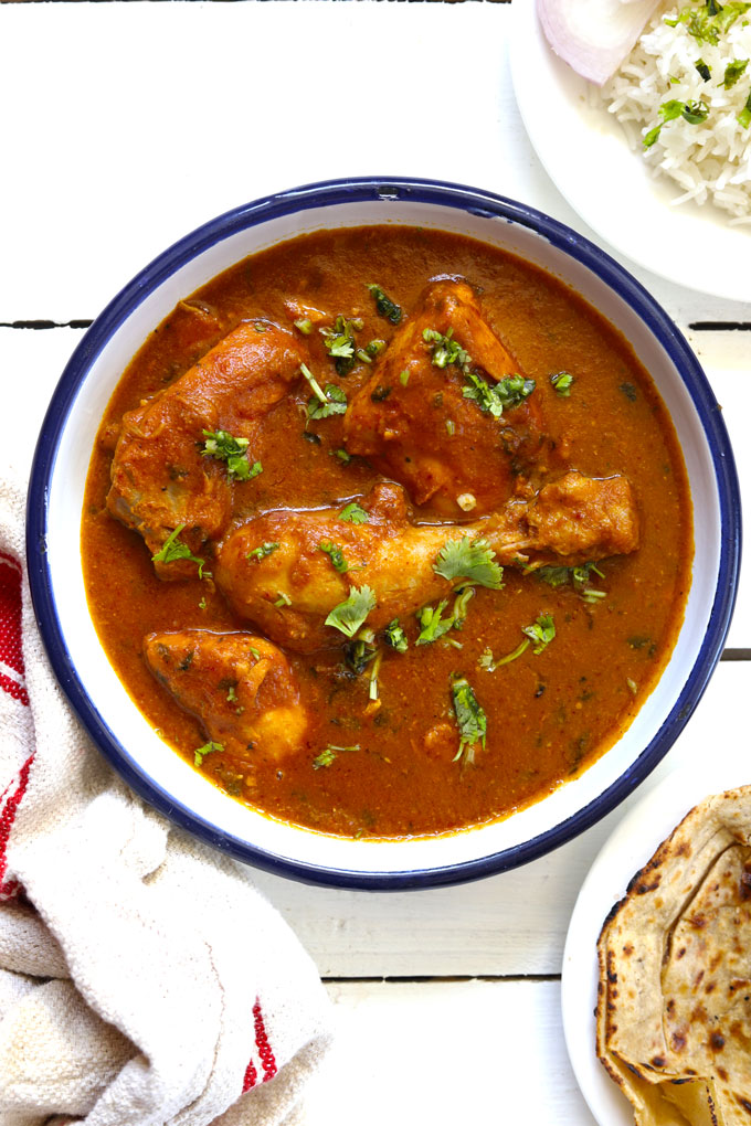aerial shot of chicken curry in a white bowl