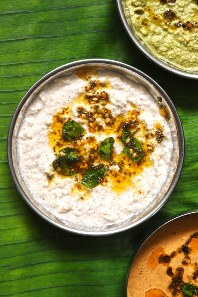aerial shot of coconut chutney in a steel serving bowl