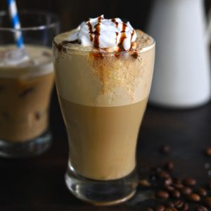 side shot of cold coffee in a glass