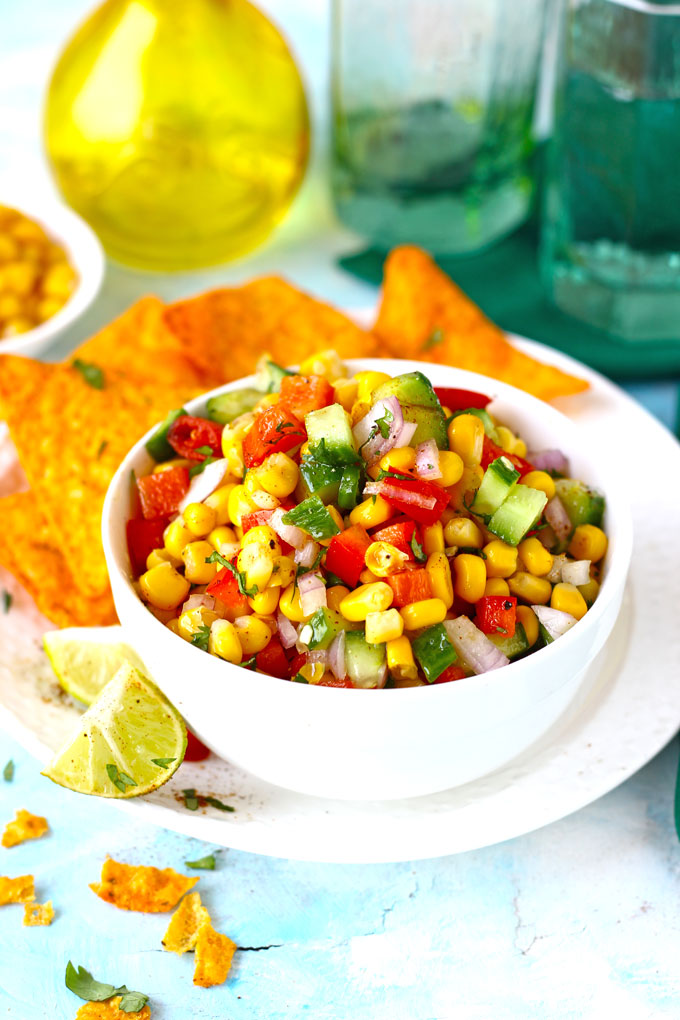 side shot of corn salad in a bowl with nachos