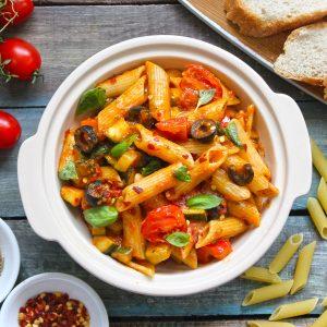 aerial shot of tomato sauce pasta in a cream ceramic bowl
