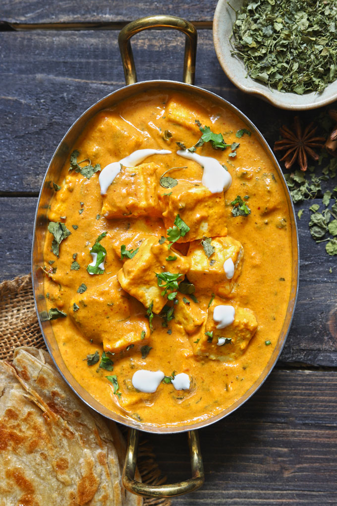 aerial shot of paneer makhani in an oval serving platter