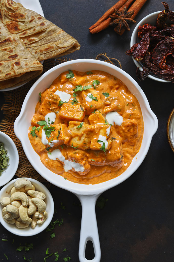 aerial shot of paneer butter masala on a white pan