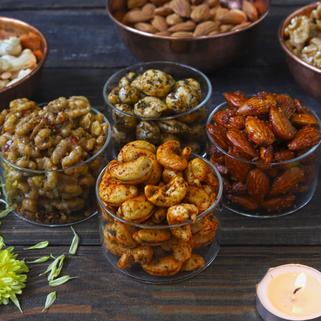 side close up shot of roasted nuts in glass bowls