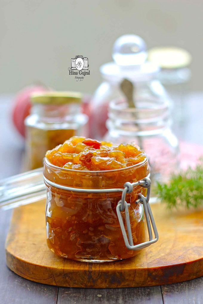 side shot of savory apple raisin chutney in a glass jar