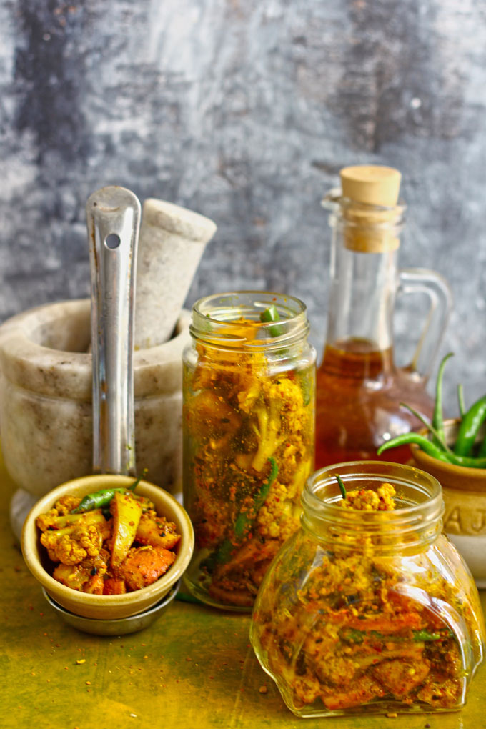 side shot of Punjabi gobi gajar achar in glass jars