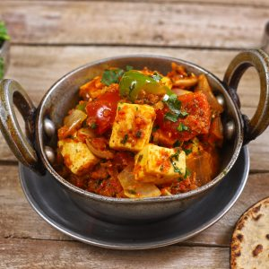 side shot of Kadai Paneer in a kadhai