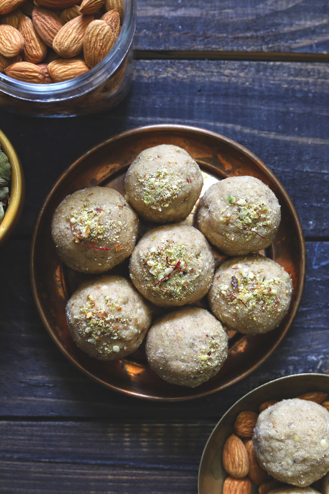 aerial shot of dry fruits wheat ladoo  arranged in a copper platter