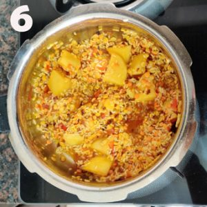 khichdi cooking process in a pressure cooker