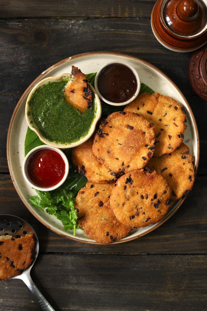 aerial shot of maddur vada with chutney stacked on a round ceramic platter