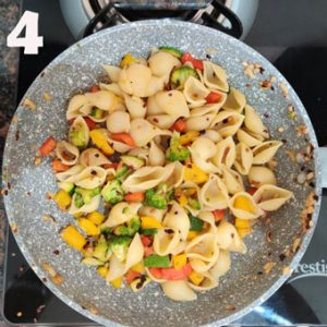 Cooking step of stir fry pasta