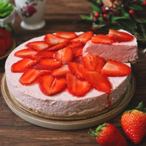 side shot of sliced no bake strawberry cheesecake