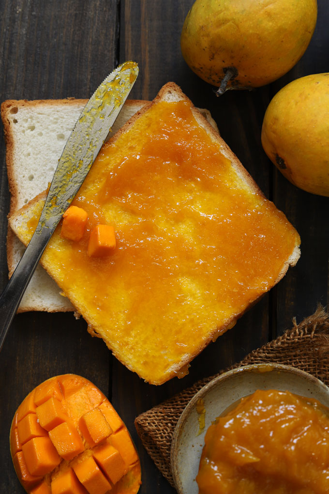 aerial shot of bread slice layered with mango jam