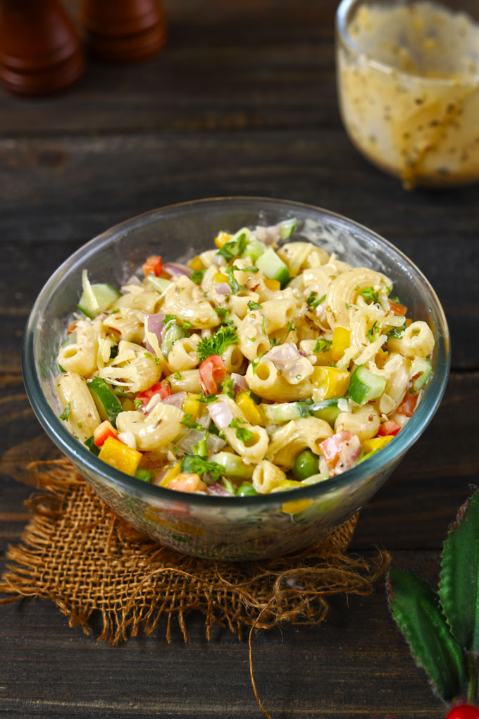 side shot of macaroni salad in a glass bowl