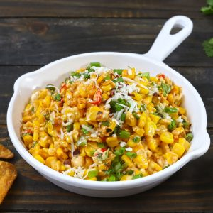 side shot of cheese chilli corn dip in a white pan