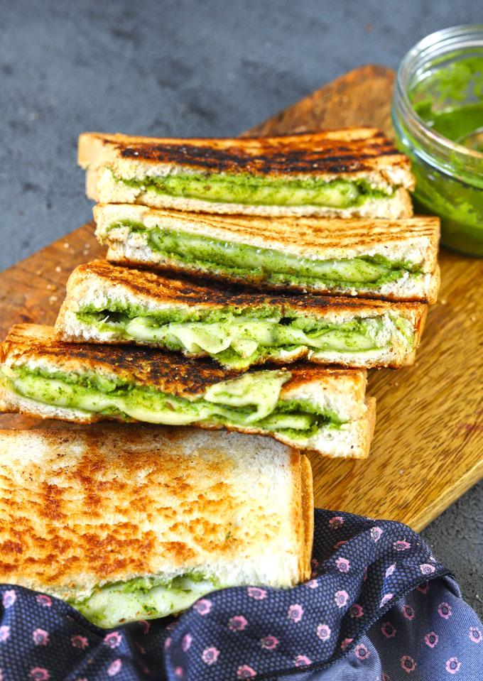 side shot of chutney sandwich stacked on a wooden platter