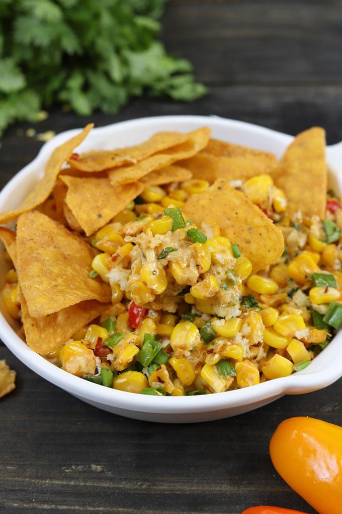 side shot of chilli corn dip with nachos